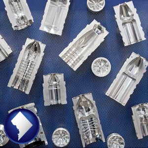 several plastic molds, made from machined metal - with Washington, DC icon