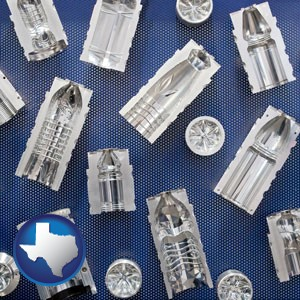 several plastic molds, made from machined metal - with Texas icon